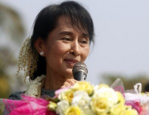 Myanmar's opposition leader Aung San Suu Kyi speaks to supporters from a vehicle at Yae Phyu village in Dawei township