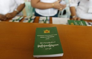 Staff sell copies of Myanmar's constitution at the Lower House of Parliament in Naypyitaw