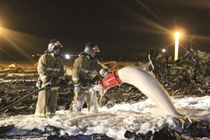 Handout photo of Russian Emergencies Ministry members and firefighters working at the site of a Tatarstan Airlines Boeing 737 crash at Kazan airport