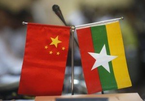 Myanmar and Chinese national flags are seen on a table during the opening ceremony of opening office of Pyithau Hluttaw Commission for Assessment of Legal Affairs and Special Issues office, in Yangon
