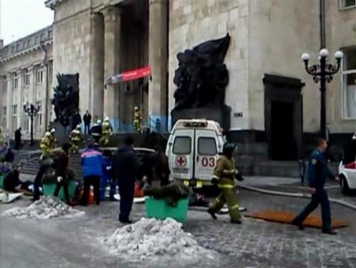 A still image taken from video shows firefighters, Emergency Ministry members and medics working outside a train station near the site of an explosion in Volgograd
