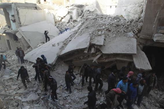Residents search for survivors after what activists said were air strikes by forces loyal to Syria's President Assad in the Maysar neighbourhood of Aleppo