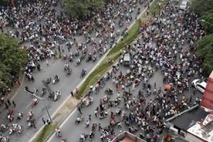 People travel along a street in Hanoi