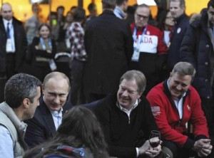 Russia's President Putin sits next to to USOC chairman Probst as he visits Team USA House at U.S. Olympic Committee headquarters in the Olympic Park during the Sochi 2014 Winter Olympics Games