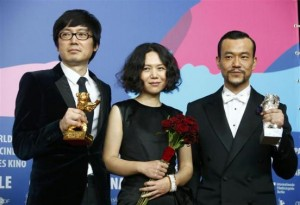 Actor Liao Fan director Diao Yinan and producer Qu pose with Silver Bear for Best Actor and Golden Bear for Best film after awards ceremony of 64th Berlinale International Film Festival in Berlin