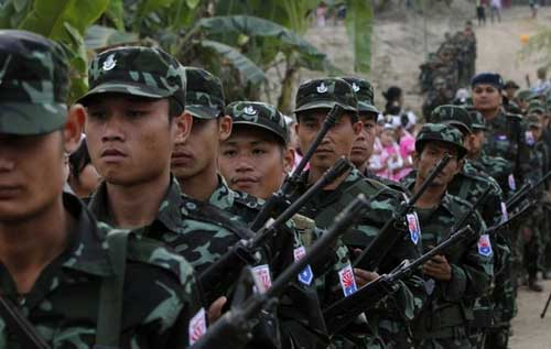 KNU army soldiers march to commemorate the 63rd anniversary of Karen Revolution Day at Oo Kray Kee Township