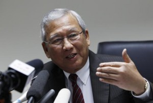 Thailand's interim prime minister Niwatthamrong Boonsongphaisan gestures during a news conference at the Permanent Secretary of Defence in Bangkok