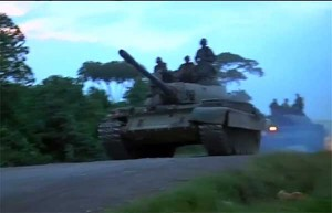 Congolese and troops gather at border