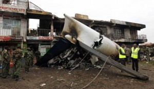 Security personnel secure scene where a cargo plane crashed into a commercial building at Utawala estate on outskirts of Kenya's capital Nairobi