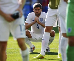 England's Gerrard squats on the pitch after their 2014 World Cup Group D soccer match against Costa Rica at the Mineirao stadium in Belo Horizonte