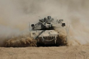 An Israeli tank manoeuvres outside the northern Gaza Strip