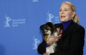"""File photo of U.S actress Lauren Bacall posing with her dog Sophie during a photocall to present her film """"The Walker"""" at the 57th Berlinale International Film Festival in Berlin"""