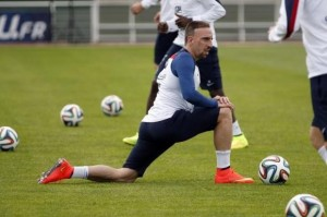 France's national soccer team forward Franck Ribery stretches during a training session in Clairefontaine