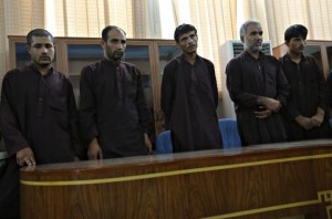 Five of seven men convicted of raping and robbing appear at a court in Kabul