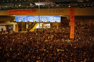 Protesters block the main street to the financial Central district, outside the government headquarters, in Hong Kong