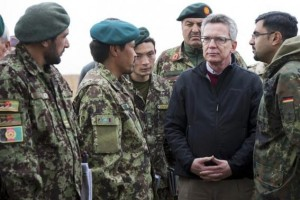 German Defence Minister de Maiziere speaks with Afghan military during his visit to Camp Shaheen outside Mazar-e-Sharif