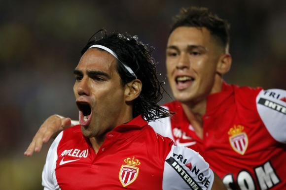 Monaco's Radamel Falcao (L) celebrates after scoring against Nantes during their French Ligue 1 soccer match at the Beaujoire in Nantes