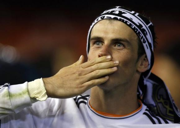 Real Madrid's Gareth Bale celebrates after winning the King's Cup final soccer match against Barcelona at Mestalla stadium in Valencia