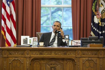 U.S. President Obama talks on the phone with Iranian President Rouhani in the Oval Office at the White House in Washington