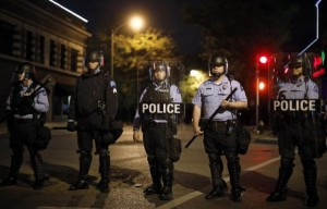 Police officers block an intersection during a protest after a vigil in St. Louis, Missouri