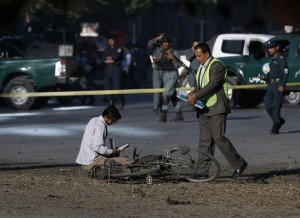 Afghan security personnel investigate at the site of a suicide attack in Kabul