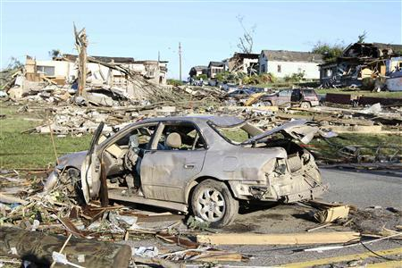 The aftermath of overnight tornadoes show destroyed homes and vehicles in Pratt City