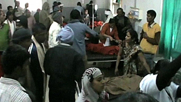 Train slams into school bus in northern India, killing five and injuring 25