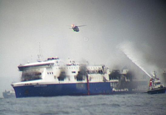 A rescue helicopter flies over  the burning car Ferry Norman Atlantic