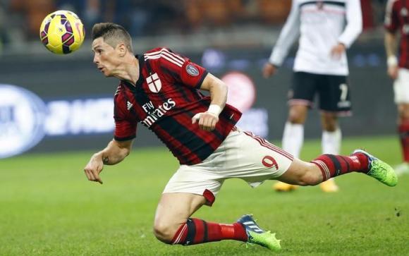 AC Milan's Fernando Torres heads the ball during their Serie A soccer match against Palermo at San Siro stadium in Milan