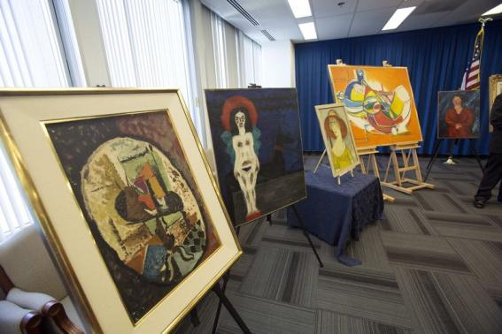 Recovered paintings are pictured during a news conference at FBI Headquarters in Los Angeles
