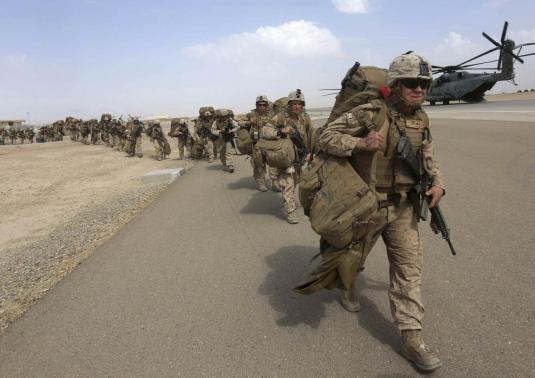 U.S. Marines prepare to depart upon the end of operations for Marines and British combat troops in Helmand