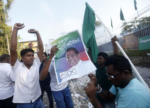Supporters of presidential candidate Mithripala Sirisena celebrate on a road