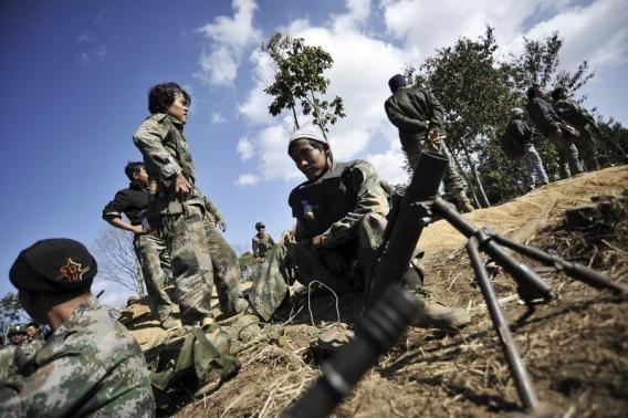 Soldiers of Kachin Independence Army (KIA) man their position at the front line near Mai Ja Yang in Kachin state