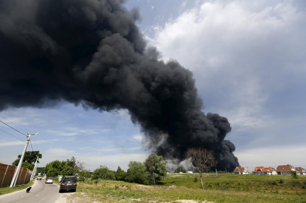 Smoke rises from a fuel depot where a fire broke out, near Vasylkiv in Kiev region, Ukraine