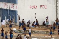 Inmates walk amid tension as confrontation between rival gangs continue in the Alcacuz prison in Nizea Floresta, near Natal, Brazil, Friday, Jan. 20, 2017. (AP Photo/Felipe Dana)
